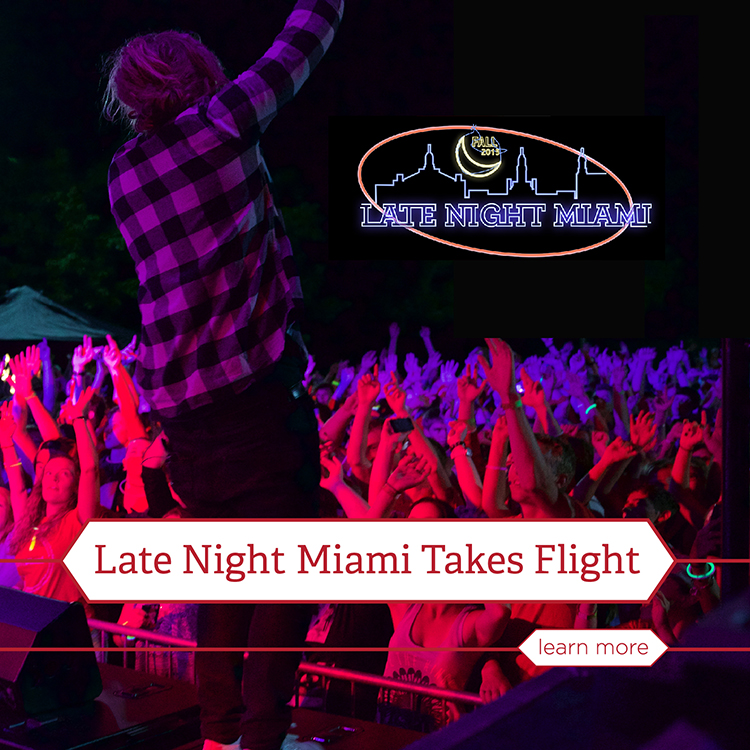 Late Night Miami Takes Flight. Learn more. A band performs on a stage at night as a crowd of students bathed in red and purple light cheers